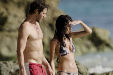 Howard Donald is pictured on the beach while on holiday in Barbados.  Pictured: Katie Halil and Howard Donald  Ref: SPL302857  030811   Picture by: Islandpaps / Splash News  Splash News and Pictures Los Angeles:	310-821-2666 New York:	212-619-2666 London:	870-934-2666 photodesk@splashnews.com