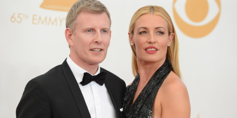 Patrick Kielty, left, and Cat Deeley arrive at the 65th Primetime Emmy Awards at Nokia Theatre on Sunday Sept. 22, 2013, in Los Angeles.  (Photo by Jordan Strauss/Invision/AP)