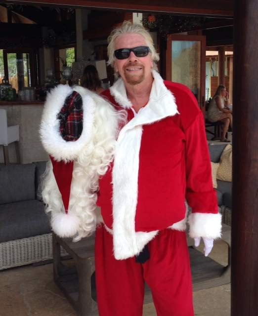 Father Christmas and his Elf deliver presents on Necker