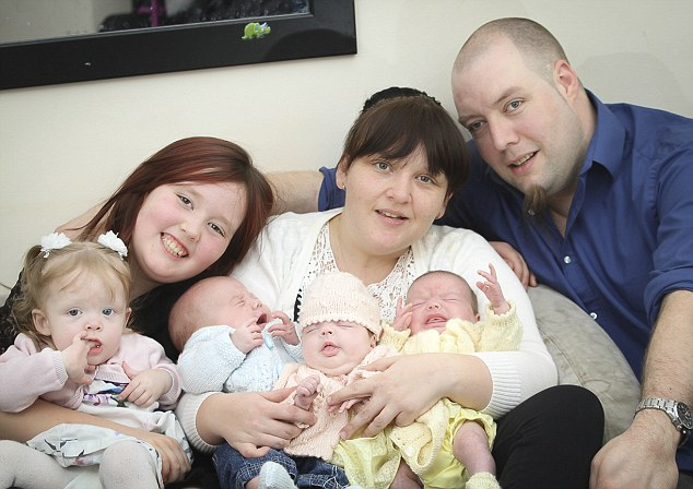 Becky Johns with partner Jason Evans and their triplets Ryan, Raya  and Phoebe. And daughters Kayla, nine, Maya, one