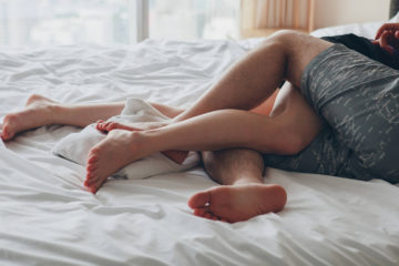 young sexy couple in love lying in bed in hotel, embracing on white sheets, close up legs, romantic mood; Shutterstock ID 345013826; PO: today.com